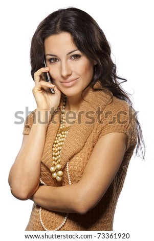 Young beautiful female talking on cell phone isolated on white background - stock photo