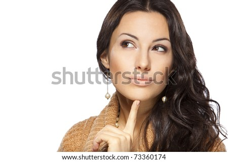 Young beautiful female thinking and pondering over something with her finger on the chin isolated on white background