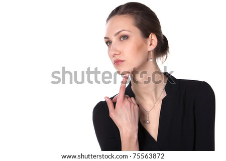 Young beautiful female thinking and pondering over something with her finger on the chin isolated on white background, with copy-space - stock photo