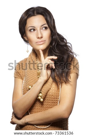 Young beautiful female thinking and pondering over something with her finger on the chin looking aside isolated on white background - stock photo