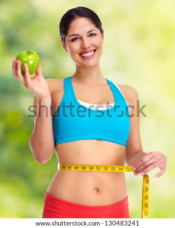 Young beautiful fitness woman. Health care background. - stock photo