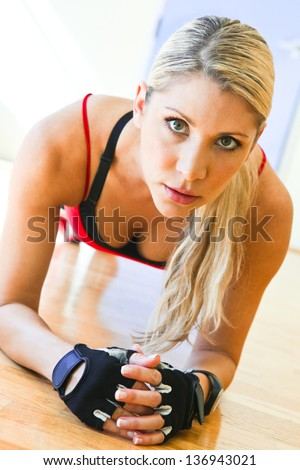young beautiful fitness woman stretching - stock photo