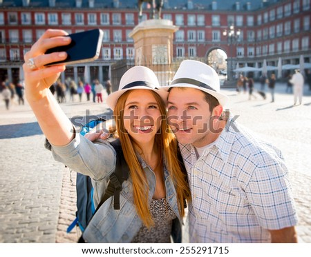 young beautiful friends tourist couple visiting Europe in holidays exchange students and taking selfie picture together in town smiling happy on sunny day in travel and vacation concept - stock photo