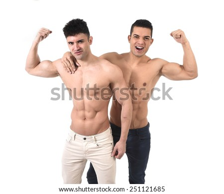 young beautiful gay couple of homosexual attractive men together in love happy having fun with naked torso and ripped fit body and abdomen six pack isolated on white - stock photo
