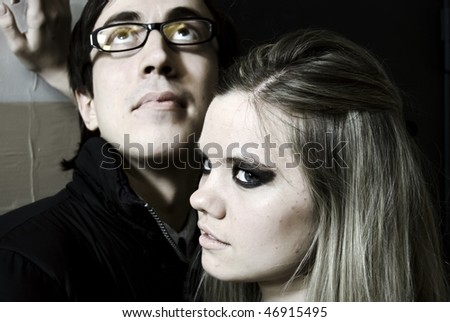 Young beautiful girl and her boyfriend - stock photo
