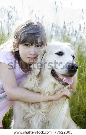 Young beautiful girl and her dog - stock photo