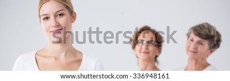 Young beautiful girl and her mother and grandmother - stock photo