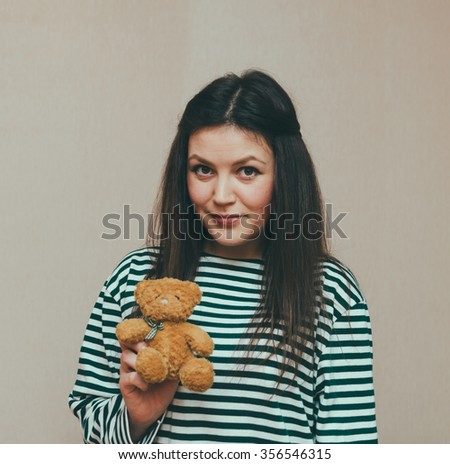 Young beautiful girl and her teddy bear - stock photo