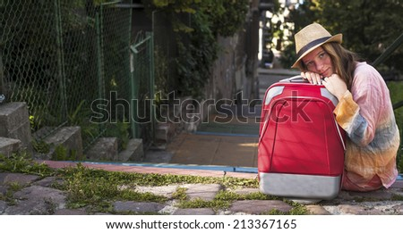 Young beautiful girl and red suitcase, travel concept. - stock photo
