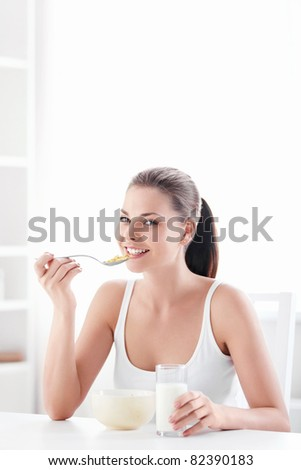 Young beautiful girl at breakfast - stock photo