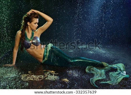 Young beautiful  girl at the image of mermaid - stock photo