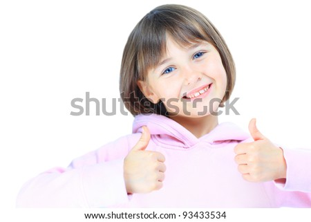 Young beautiful girl  child shows thumb up. Isolated on white background. - stock photo