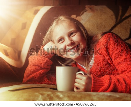 Young beautiful girl child with cup of coffee.