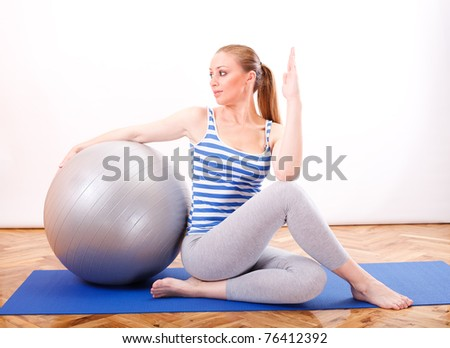 young beautiful girl doing relaxation with pilates ball