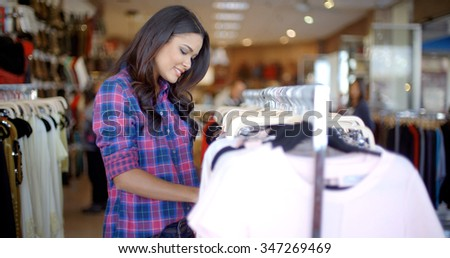 Young beautiful girl doing shopping in a clothing store