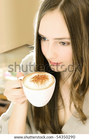 young beautiful girl drinking a morning coffee