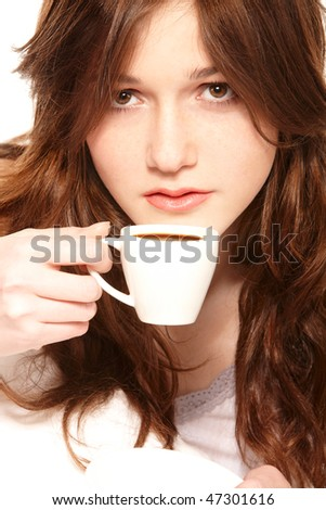 Young beautiful girl drinking coffee in bed in the morning - stock photo