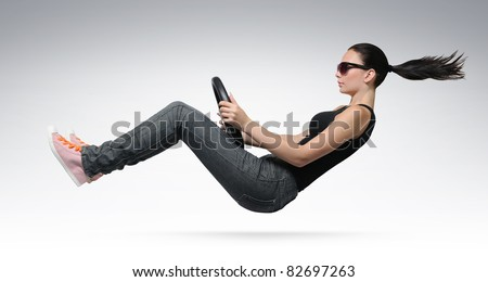 Young beautiful girl driver in sunglasses with a wheel, concept - stock photo
