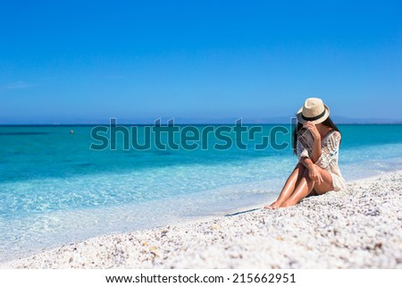 Young beautiful girl during italian vacation on white beach