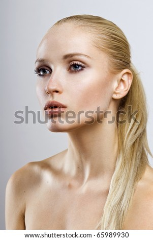 young beautiful girl face. perfect skin - stock photo