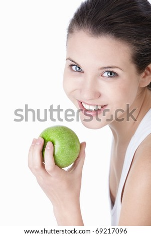 Young beautiful girl holding a green apple on a white background - stock photo