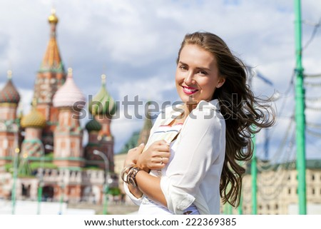 Young beautiful girl holding a tourist map of Moscow, Russia - stock photo