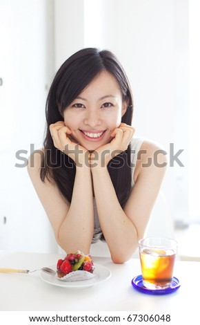 Young beautiful girl in a cafe