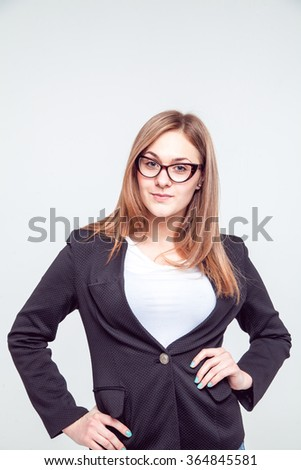 Young, beautiful girl in a jacket, isolated on a white background. glasses