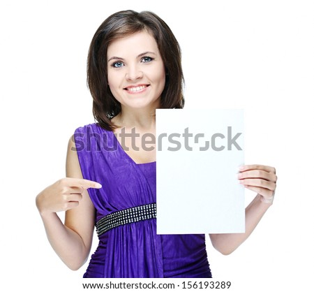 young beautiful girl in a violet dress, holding a poster and shows a finger at him.Isolated on white background