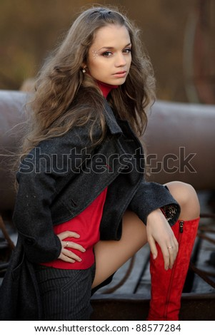 Young beautiful  girl in autumn background - stock photo