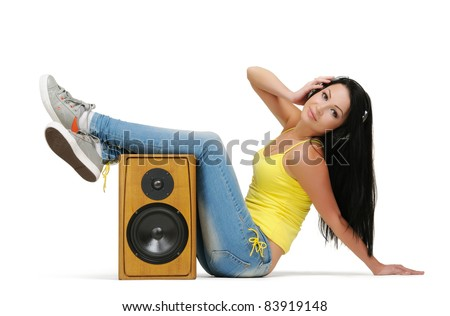Young beautiful girl in headphones with wooden speaker on white background, sound concept - stock photo