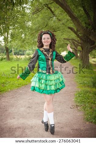 young beautiful girl in irish dance dress and wig posing outdoor - Irish Dancer Halloween Costume