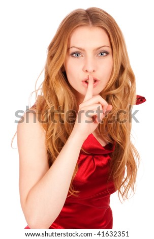 Young beautiful girl in red dress calls for silence, it is isolated on white background.