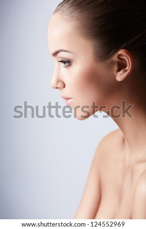 Young beautiful girl in studio - stock photo