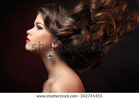Young beautiful girl in studio - stock photo