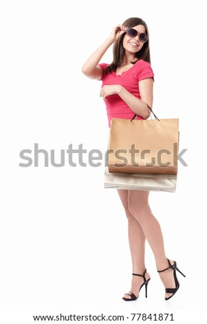 Young beautiful girl in sunglasses with bag isolated - stock photo