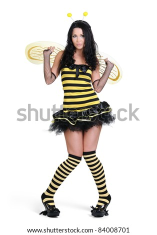 Young beautiful girl in the bee costumes on white background - stock photo