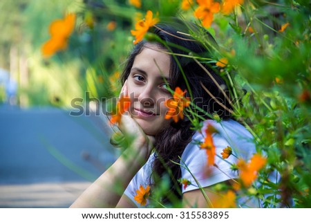 young beautiful girl in the field in summer