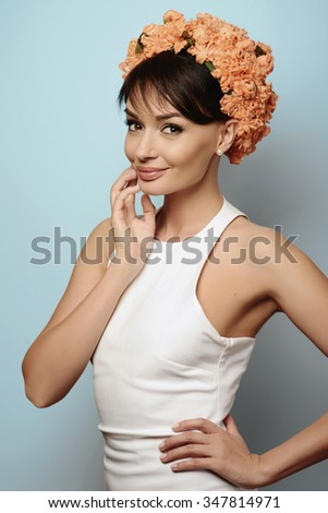 Young beautiful girl in the flower crown