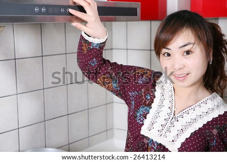 young beautiful girl in the kitchen - stock photo