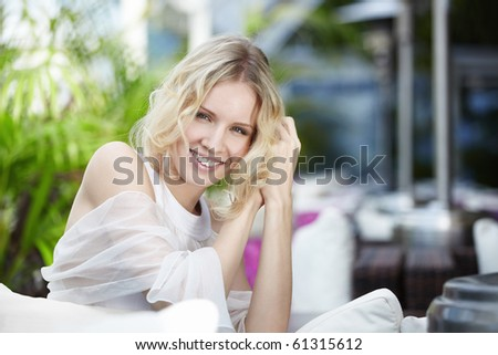 Young beautiful girl in the restaurant - stock photo