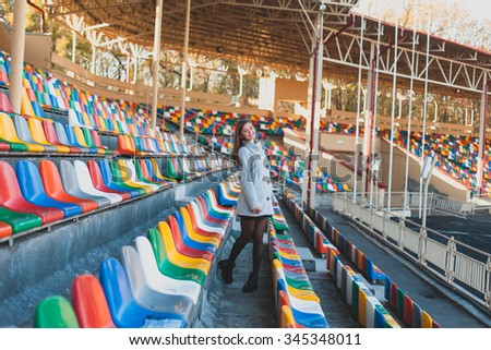 Young beautiful girl in the stadium