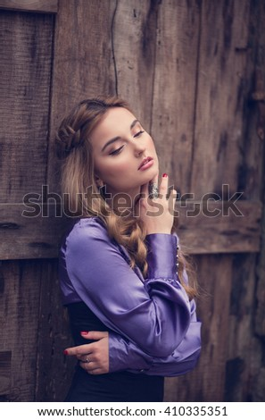 Young beautiful girl in vintage romantic antique dress near the vintage wooden door. fairy tale, legend - stock photo