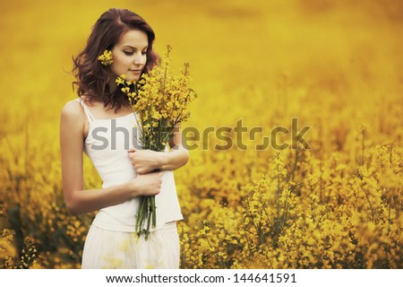 young beautiful girl in yellow field - stock photo
