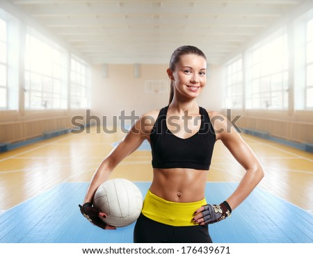 young beautiful girl indoor in volleyball game sport arena - stock photo