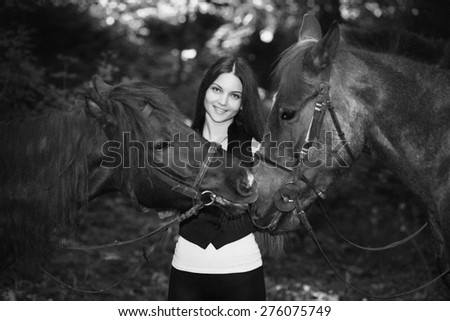 Young beautiful girl, lady, woman, model, rider. Slim figure, attractive, cute appearance, chic long hair. Stylish look. Nature, relaxation, farm, horseback riding, equestrian sport, free horse racing - stock photo
