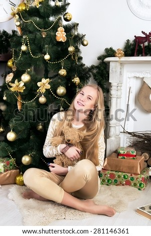 Young beautiful girl, lady, woman, teenage, blonde, model. Celebratory atmosphere, new year, Christmas tree, gifts, holidays. Home stylish look, natural fresh makeup, slim figure, luxurious long hair - stock photo