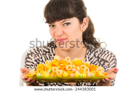 young beautiful girl looking at junk food chips disgusted isolated on white - stock photo