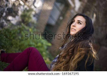 Young beautiful girl looking to infinite. - stock photo