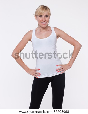 Young beautiful girl making fitness exercise on white background in studio